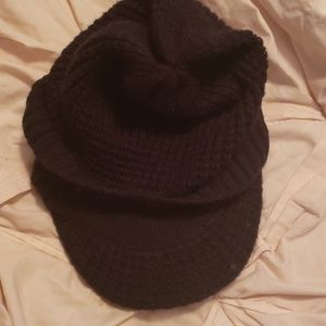 Black knit stretchable hat.